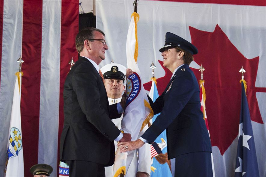 Defense Secretary Ash Carter hands the U.S. Northern Command flag to Air Force Gen. Lori J. Robinson