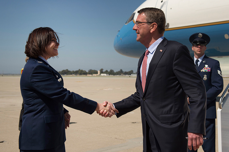 Defense Secretary Ash Carter shaking hands with Air Force Col. Rosemary M. Smith, commander of the 129th Maintenance Group.