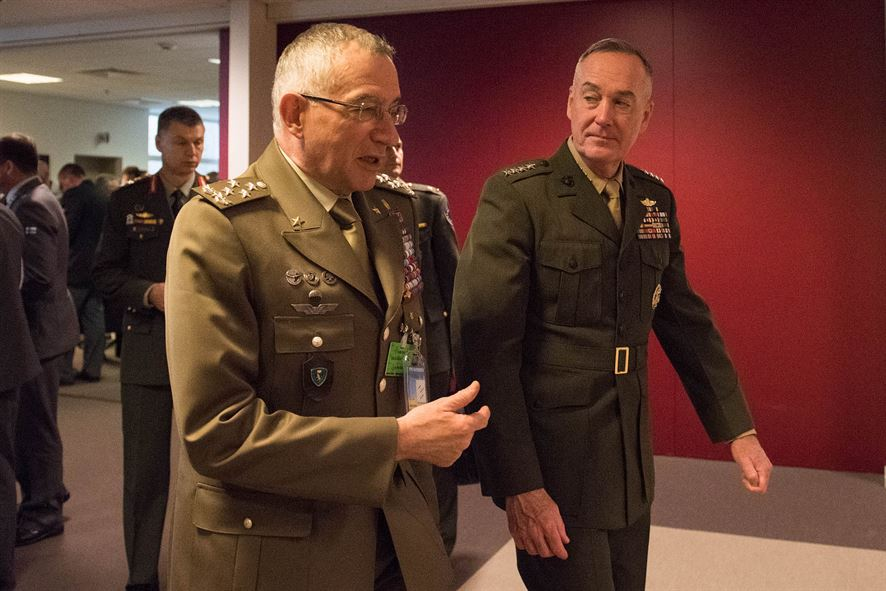 Marine Corps Gen. Joe Dunford, right, chairman of the Joint Chiefs of Staff, talks with Italian Chief of Defense Gen. Claudio Graziano