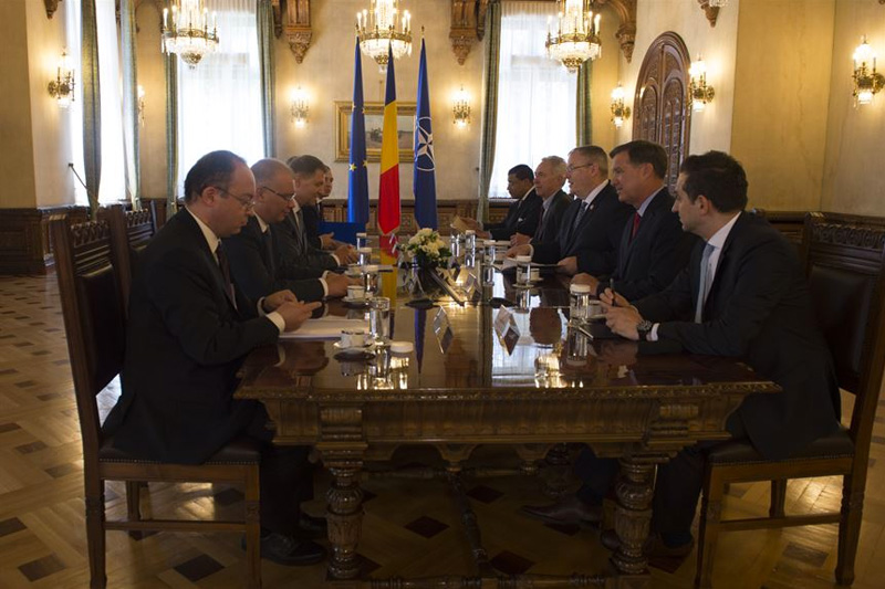 Deputy Defense Secretary Bob Work attends a bilateral meeting with Romanian President Klaus Iohannis