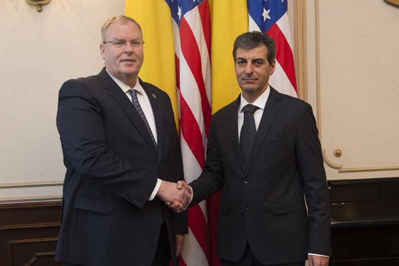 Deputy Defense Secretary Bob Work poses for a photograph with Romanian Defense Minister Mihnea Motoc