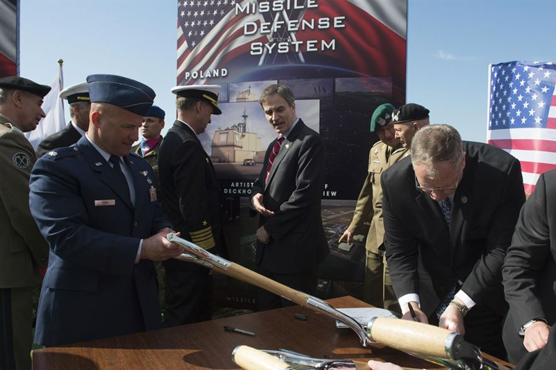 Deputy Defense Secretary Bob Work signs a ceremonial shovel