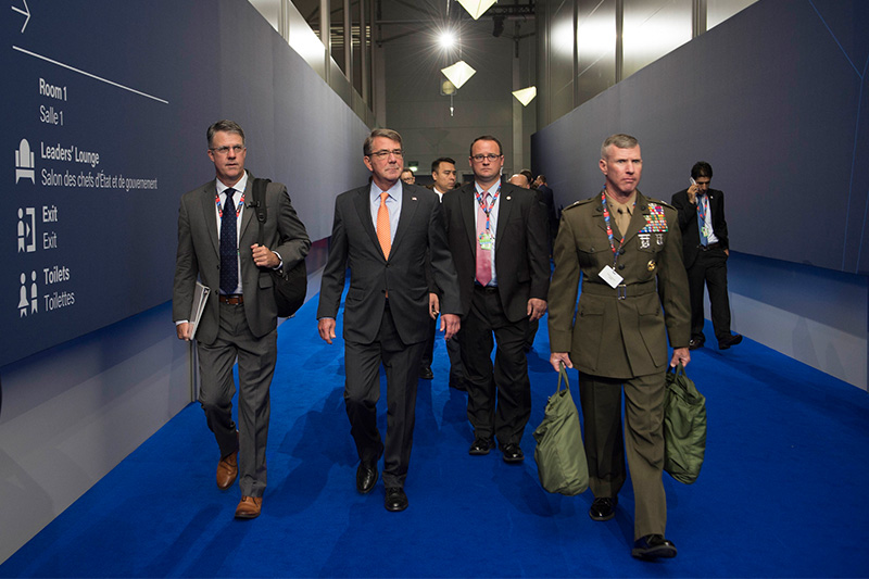 Defense Secretary Ash Carter, second from left, and his staff arrive at the NATO Summit in Warsaw, Poland.