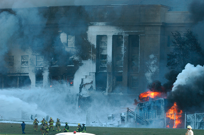 Local police, firefighting units and first responders battle to put out the fires raging in the Pentagon