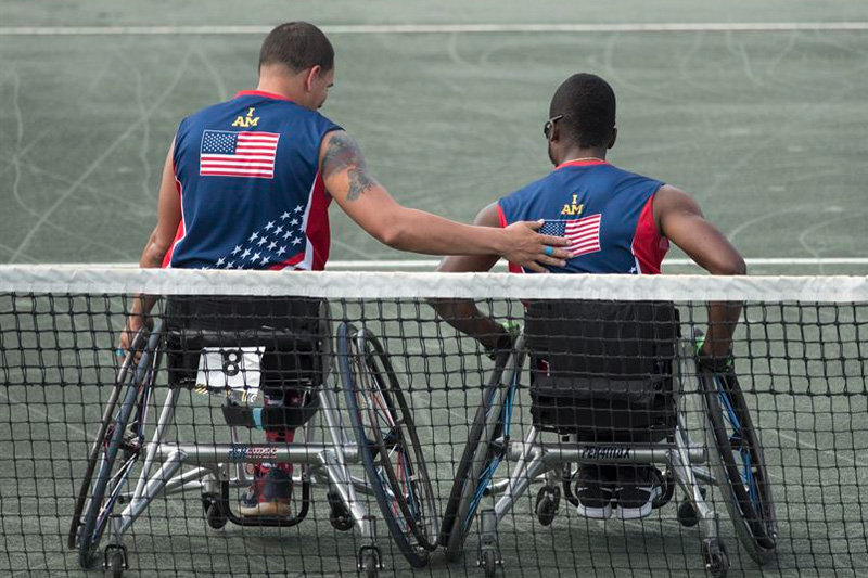 Army veteran R.J. Anderson, right, and Navy veteran Javier Rodriguez leave the court after playing the New Zealand team in the wheelchair tennis semifinals
