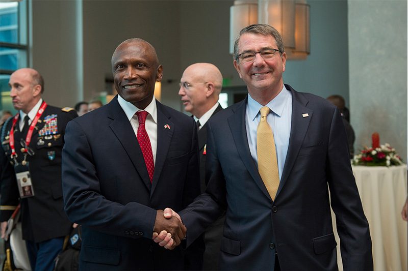 Secretary of Defense Ash Carter greets U.S. Ambassador to Trinidad and Tobago John Estrada