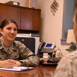 Air Force Capt. Catherine Santiago, Air Force Legal Operations Special Victims' Counsel attorney, speaks with a client at Malmstrom Air Force Base, Mont., Sept. 30, 2016.