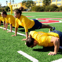 Sailors perform pushups during a physical training session at Marine Corps Recruit Depot San Diego, Feb. 25, 2013.
