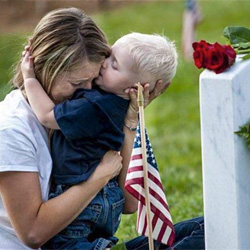 Brittany Jacobs hugs her 17-month old son Christian at her husband, Marine Sgt. Christopher Jacobs' gravesite at Arlington National Cemetery, Va., May 25, 2013.