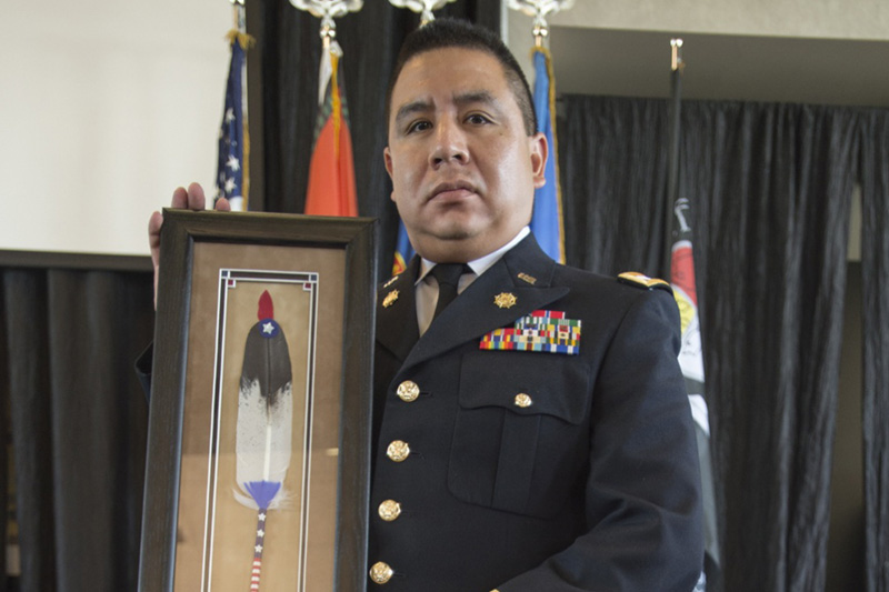 Oklahoma Army National Guardsman Capt. Warren Queton of Blanchard, Oklahoma, receives the 2016 Society of American Indian Government Employees Military Meritorious Service Award.