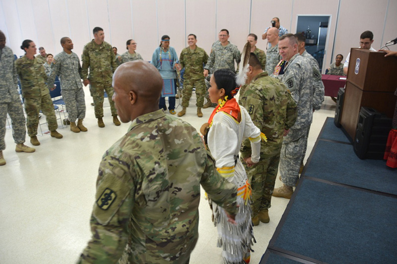 Members of 18th Medical Command (Deployment Support) participate in a traditional round dance.