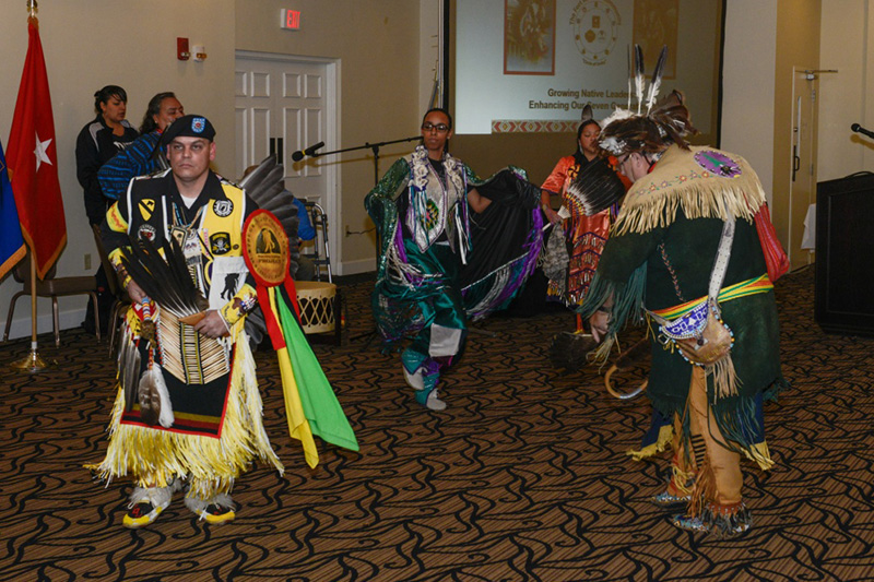 Members of the Red Road Awareness, a nonprofit organization created to assist American Indians in crisis, perform a traditional Native American dance.