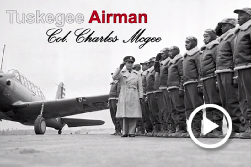Screen grab of Tuskegee Airman Col. (retired) Charles McGee standing with other airmen.