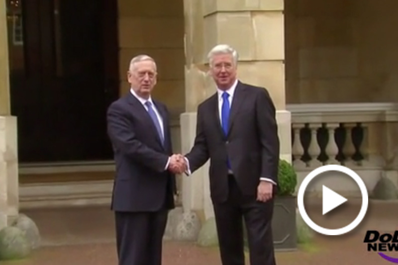 Screen grab of Defense Secretary Jim Mattis and British Defense Secretary Michael Fallon shaking hands.