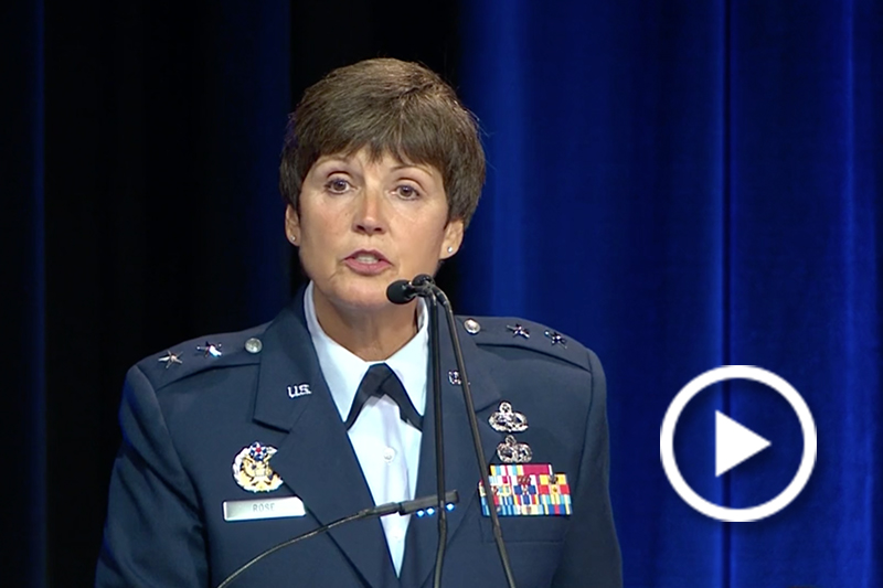 Air Force Maj. Gen. Patricia A. Rose speaking at a podium.