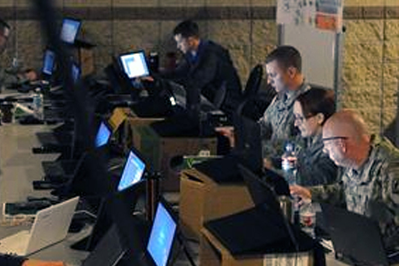 Members of the Army National Guard, Air National Guard, Army Reserve and civilian agencies prepare to engage in cyberattacks