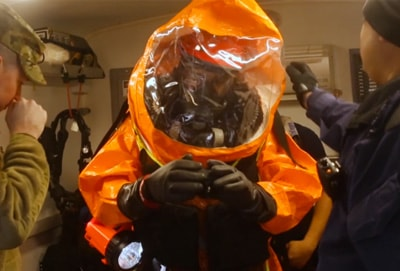 A person wearing a hazmat suit